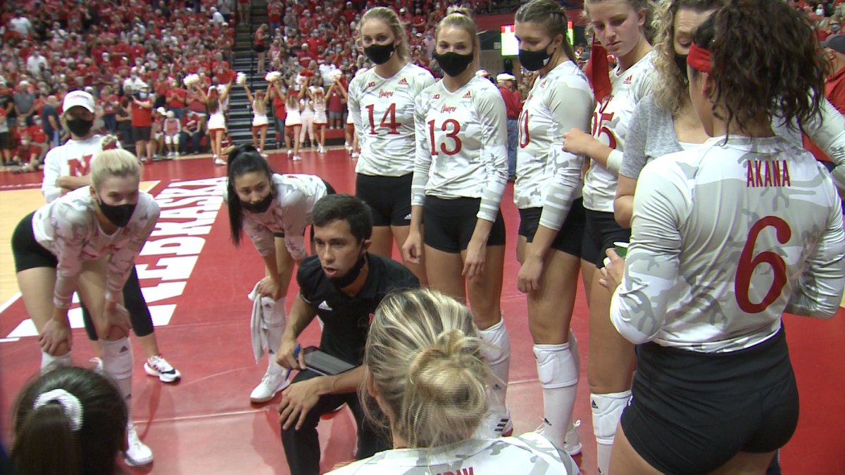 The Nebraska volleyball team huddles during a timeout at the Devaney Center.