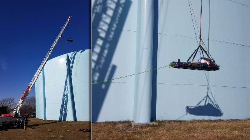 Water tower rescue: Patient lowered in basket.