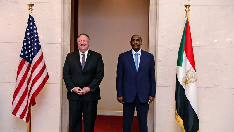 FILE - In this Aug. 25, 2020 file photo, U.S. Secretary of State Mike Pompeo stands with...