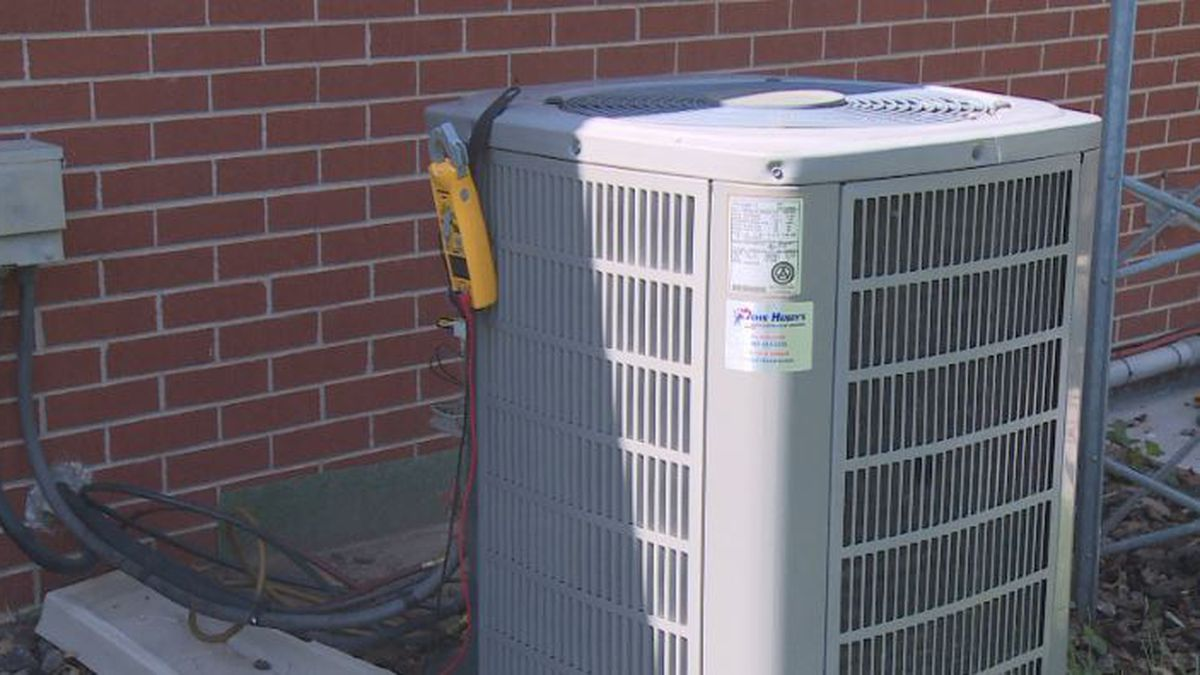 A broken AC unit is being worked on by John Henry's. They say that filters, coils and breakers are the main cause of AC problems.