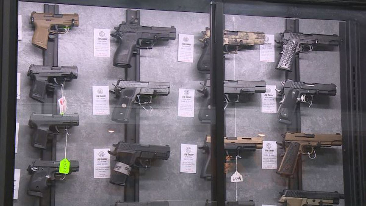 A variety of guns are on locked but on display at Big Shots in Lincoln.