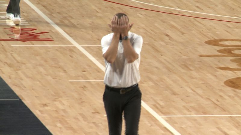 Nebraska head coach Fred Hoiberg covers his eyes during a 69-66 loss to Nevada in the Golden...