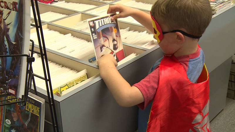 Trade-A-Tape Comic Center Downtown handed out hundreds of free comic books, many of them geared...
