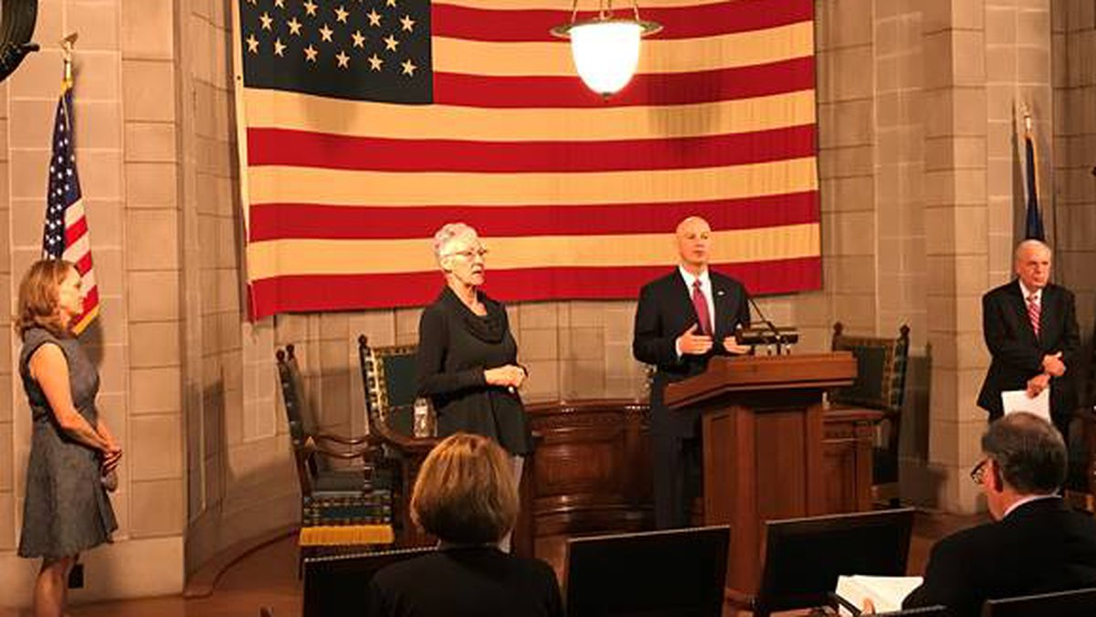 Governor Pete Ricketts speaks at the podium during Thursday's press briefing.