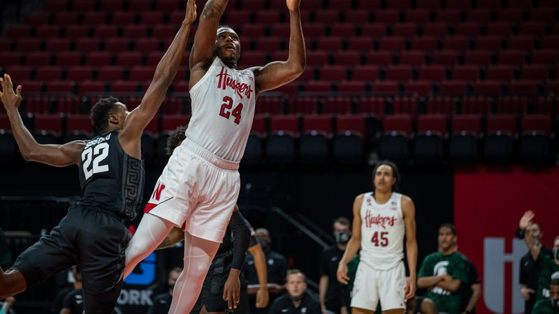 Nebraska forward Yvan Ouedraogo attempts a shot around a Michigan State defender in the...
