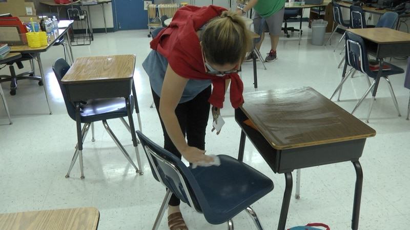 Teacher Grace Garcia prepares the classroom for when students return.
