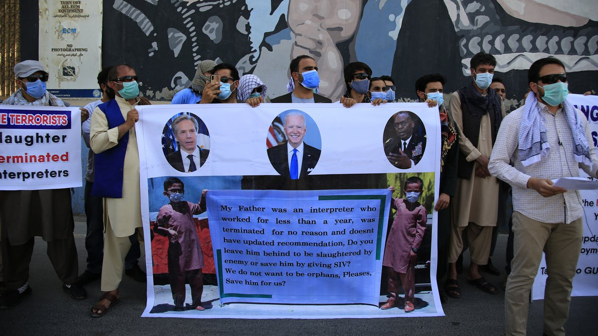 FILE - In this June 25, 2021 photo, former Afghan interpreters hold placards during a...