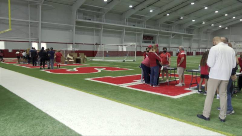 Children and their families gather in the Cook Pavilion ahead of the Husker Football game to...