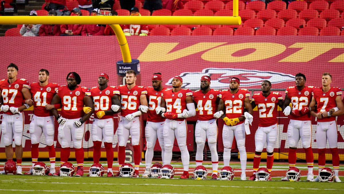 Kansas City Chiefs players stand for a presentation on social justice before an NFL football...