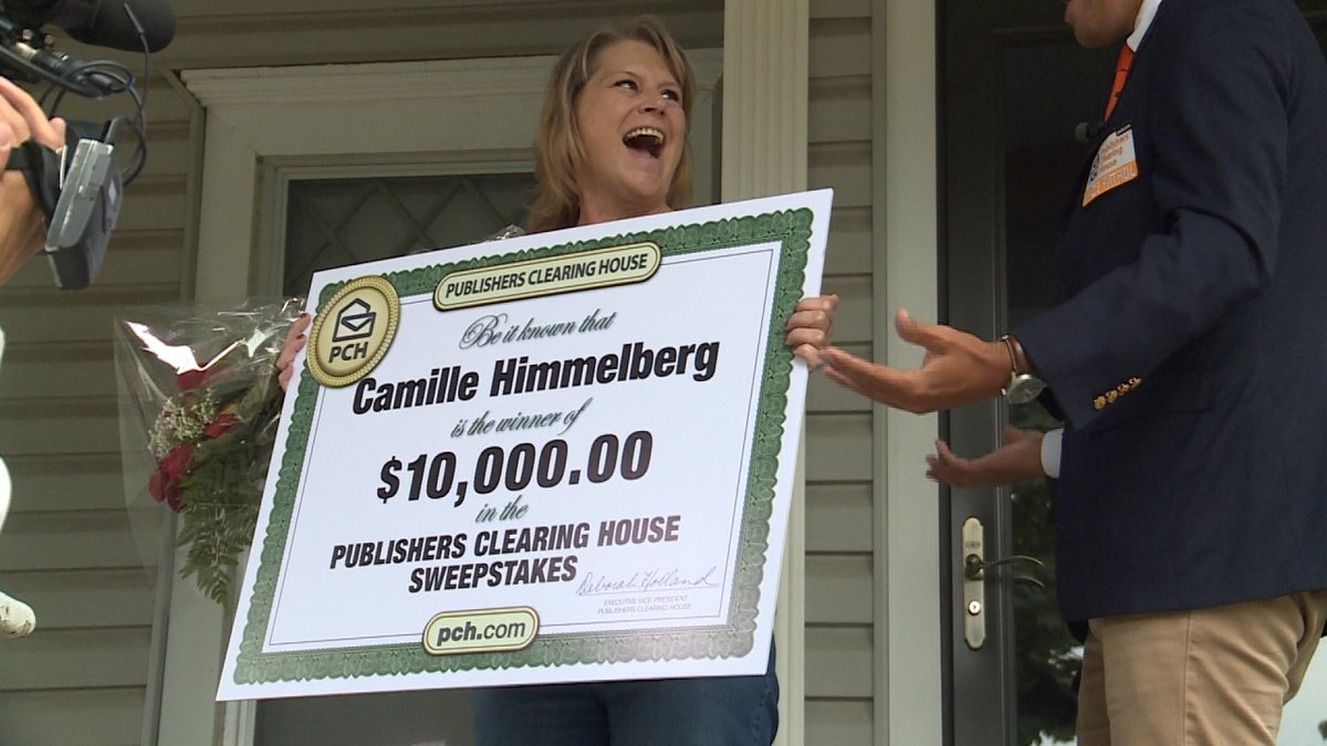 Publishers Clearing House Sweepstakes winner, Camille Himmelberg, is awarded a $10,000 check.
