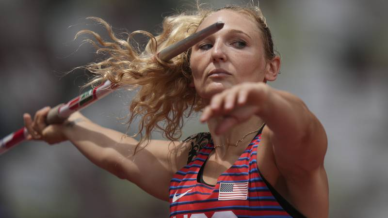 Maggie Malone, of the United States, competes in qualifications for the women's javelin throw...