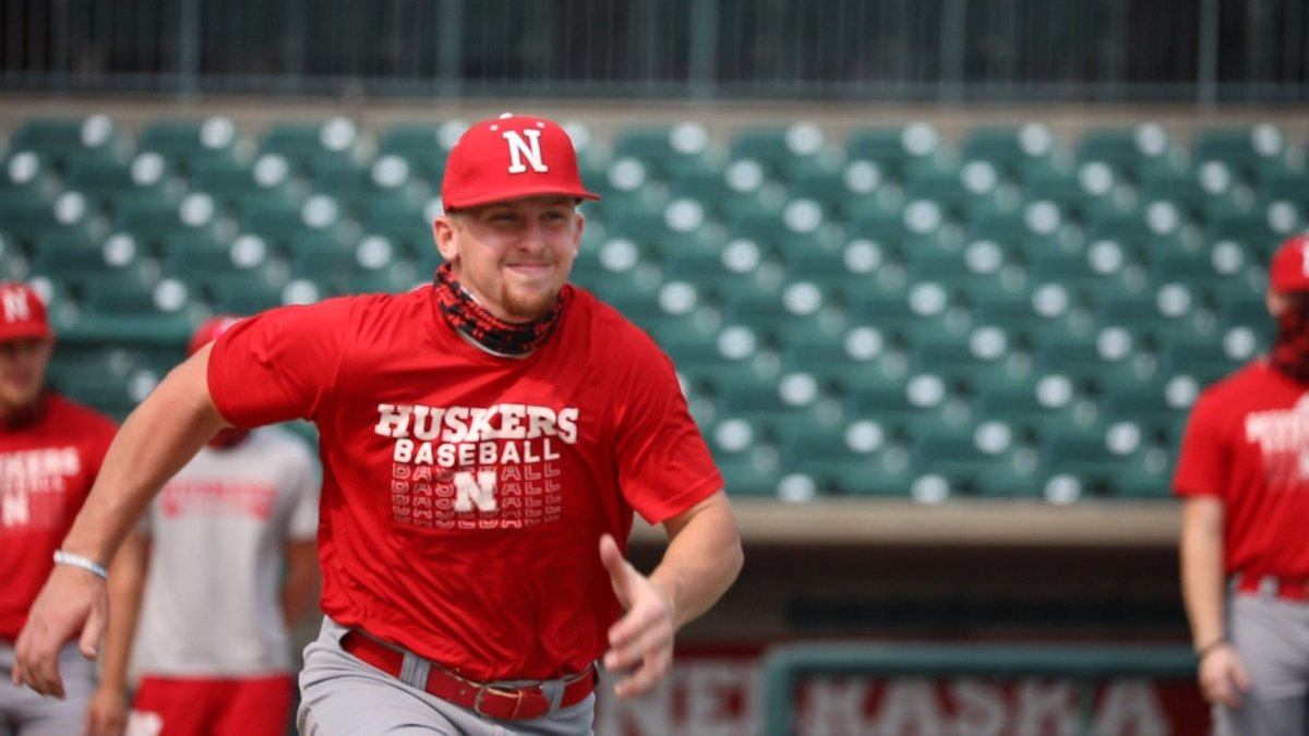 Nebraska shortstop Spencer Schwellenbach runs to first base during a practice at Hawks Field.