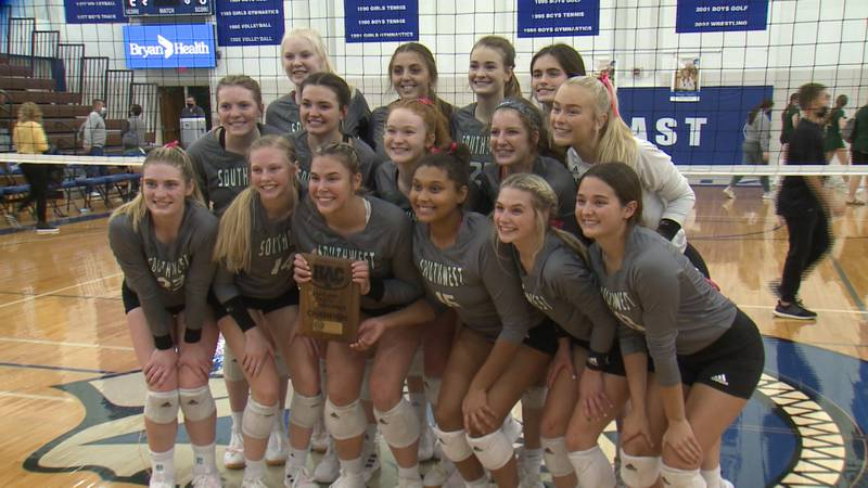 Lincoln Southwest players pose for a photo after winning the 2021 HAC volleyball championship.