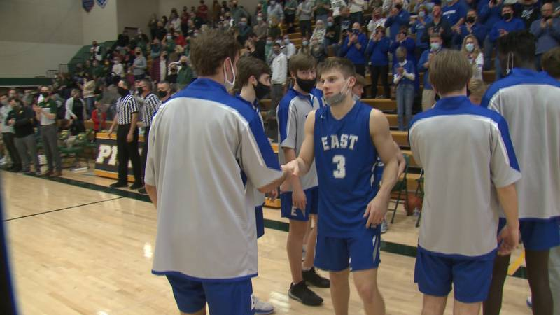 Carter Glenn is introduced prior to a high school basketball game.
