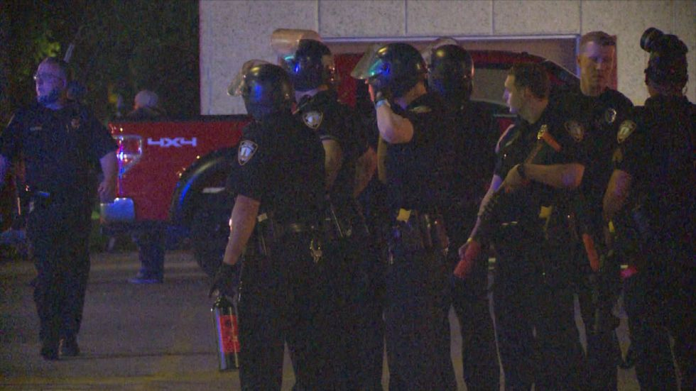Police say officers were assaulted while trying to protect the EZ Go near 25th & O Streets in...