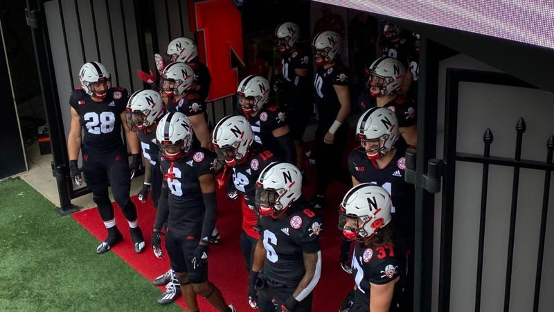 The Nebraska football team is wearing all-back uniforms against Illinois.