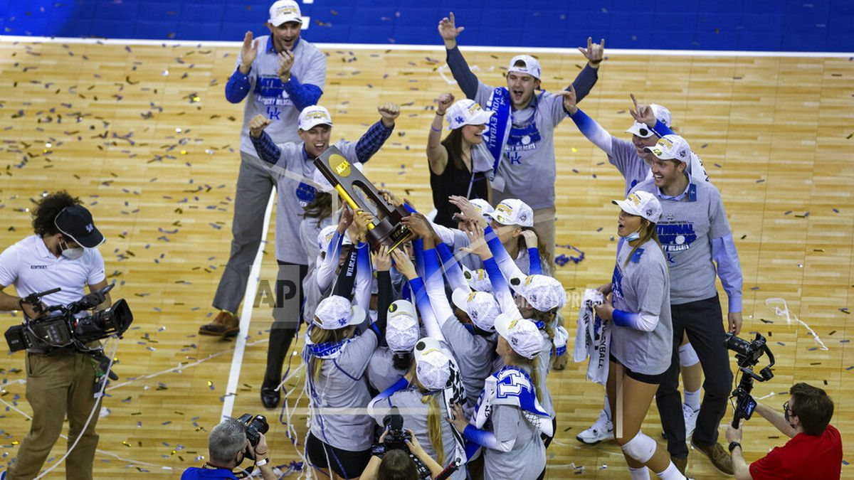 Kentucky players hold the trophy after a win against Texas in the final of the NCAA women's...