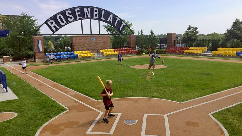 A pitch is thrown for a batter during an impromptu ball game at the Infield at the Zoo,...