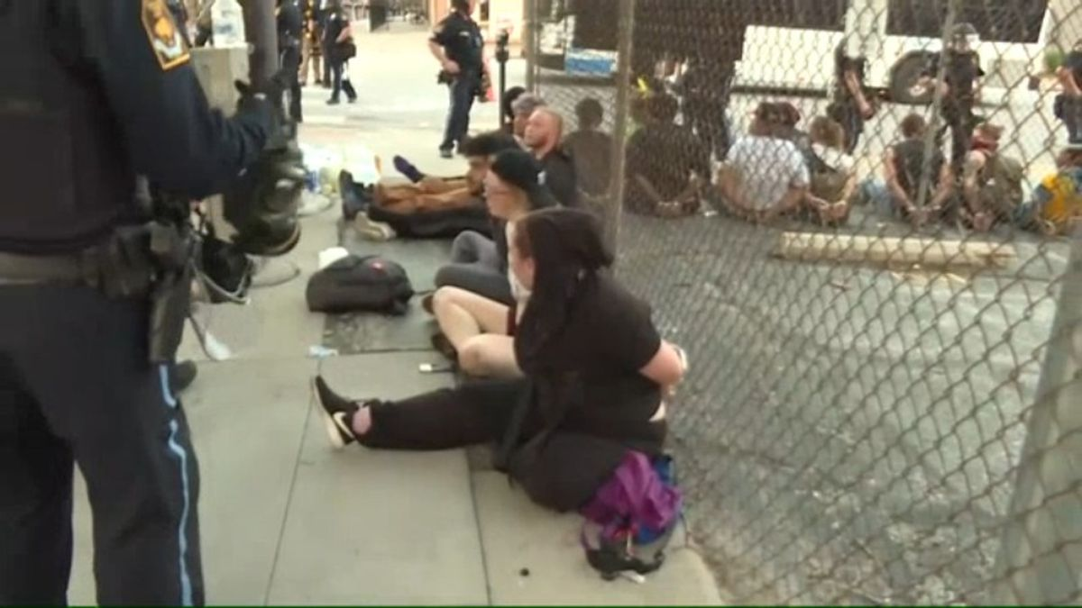 Protesters appeared to leave the downtown protest scene Monday, June 1, 2020, in the Old Market before returning to the intersection and walking through the Omaha Police line with their hands up. Arrests were made shortly thereafter. (WOWT)