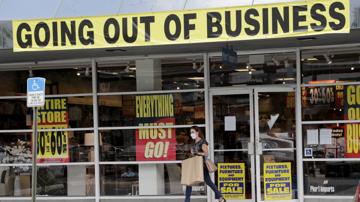FILE - In this Aug. 6, 2020 file photo, a customer leaves a Pier 1 retail store, which is going...