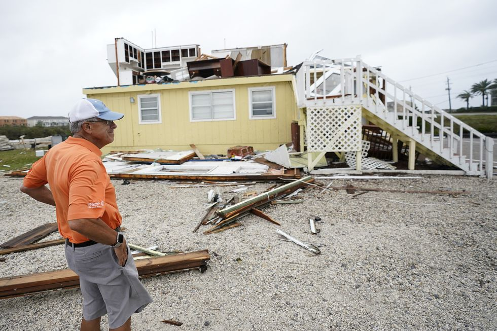 Joe Mirable surveys the damage to his business after Hurricane Sally moved through the area, Wednesday, Sept. 16, 2020, in Perdido Key, Fla. Hurricane Sally made landfall Wednesday near Gulf Shores, Alabama, as a Category 2 storm, pushing a surge of ocean water onto the coast and dumping torrential rain.