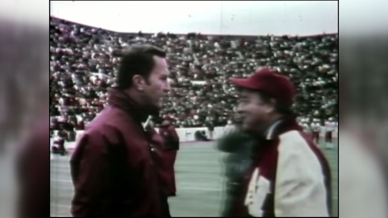 """Legendary coaches Bob Devaney and Barry Switzer meet before the """"Game of the Century"""" between..."""