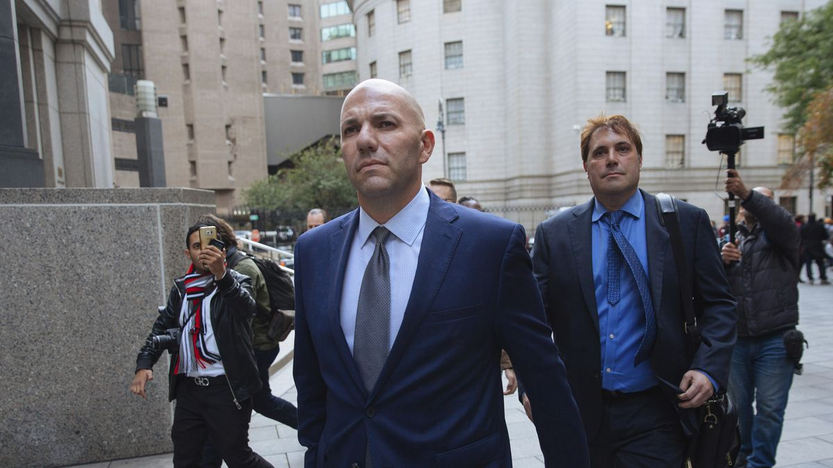 David Correia, center, leaves federal court, Thursday, Oct. 17, 2019, in New York.