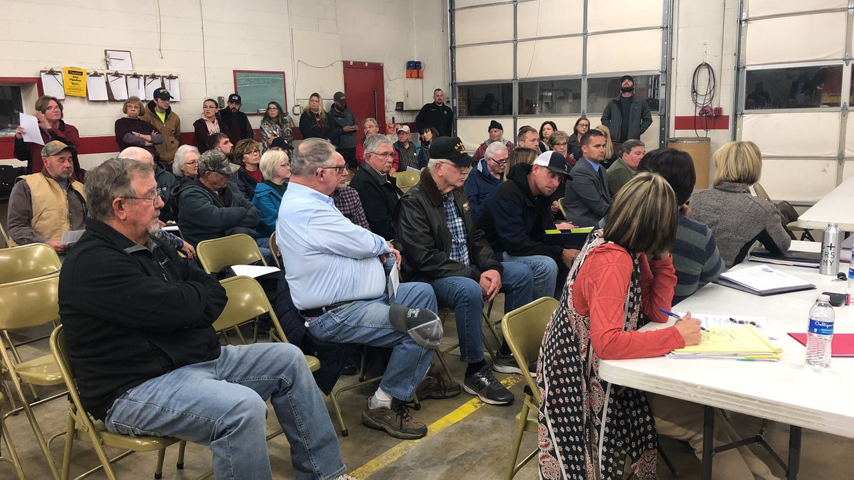 People in Friend, Nebrask meet at the fire station for a termination review hearing for former...