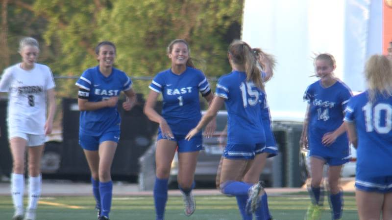 Lincoln East senior Briley Hill celebrates a goal during the Spartans win in the District A-3...
