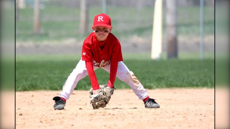 Eric Kennedy gets ready to field a ground ball during a youth baseball game.