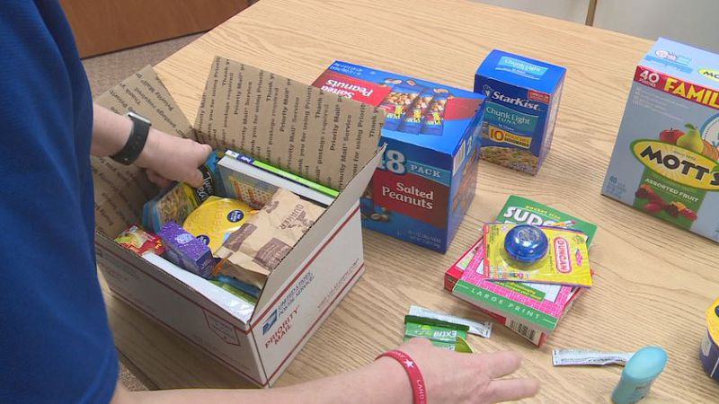 Care packages are filled with items like protein-packed snacks, wipes, games and drink mixes.