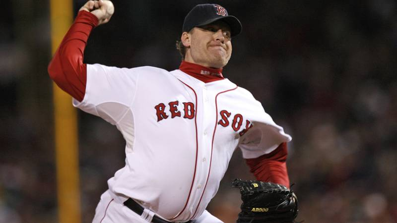 FILE - In this Oct. 25, 2007, file photo, Boston Red Sox's Curt Schilling pitches against the...