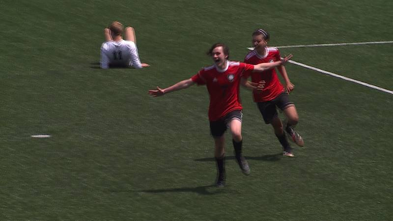 Mount Michael players celebrate following a goal at the NSAA State Soccer Tournament.