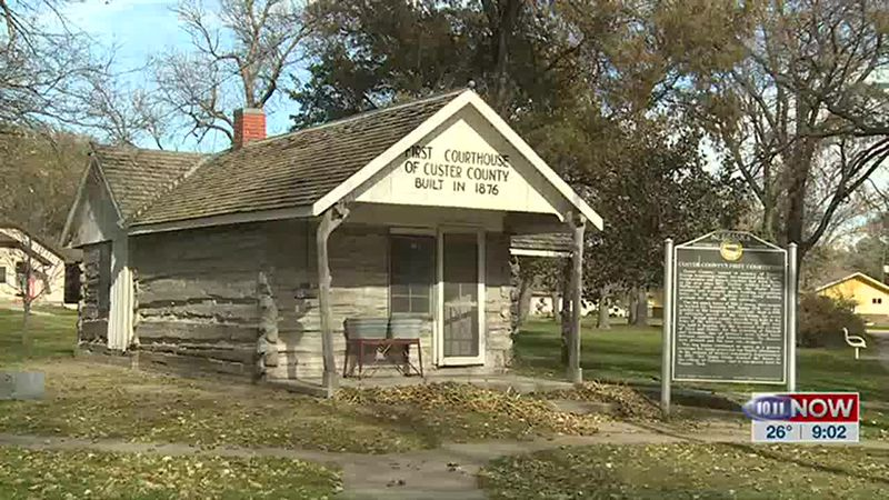 We get a tour of a log cabin that used to serve as Custer County's first courthouse.