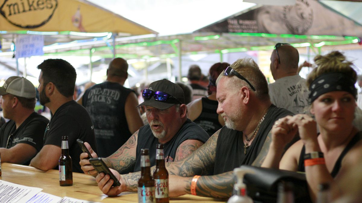FILE - In this Aug. 7, 2020 file photo, people congregate at One-Eyed Jack's Saloon during the...