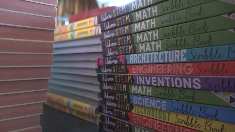 Book drive provides local kids in foster care with books, backpacks
