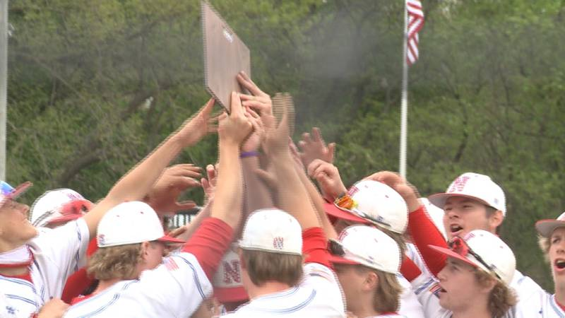 The Norris Titans celebrate after defeating Mount Michael 13-4 in the B-2 tournament.
