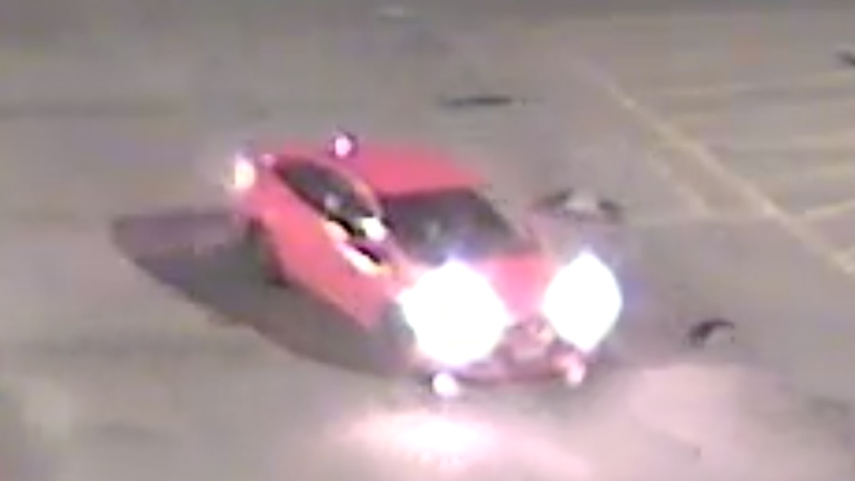 Omaha Police are looking for the red Ford sedan with front bumper damage to interview occupants...