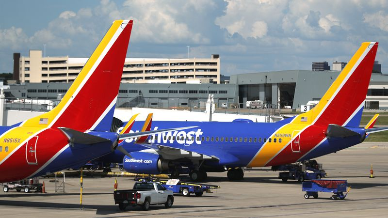 FILE - In this Wednesday, June 24, 2020, file photo, Southwest Airlines jets sit at gates at...
