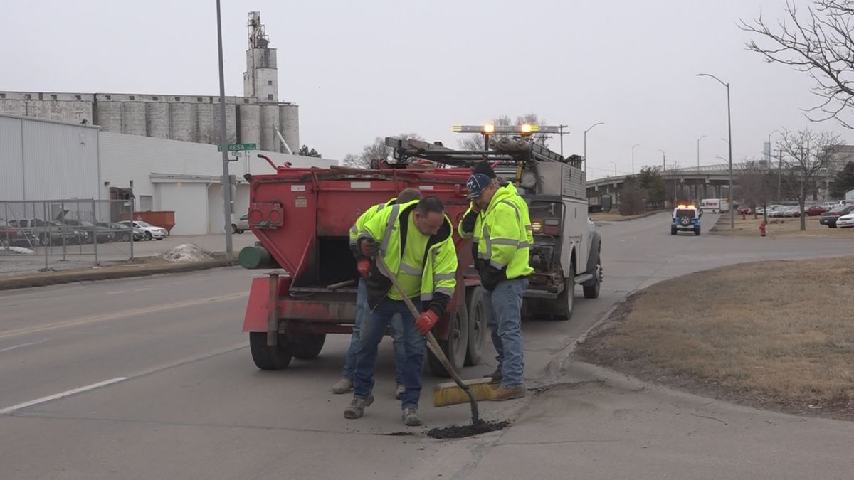 Crews work to repair a pothole. (Source: KOLN)