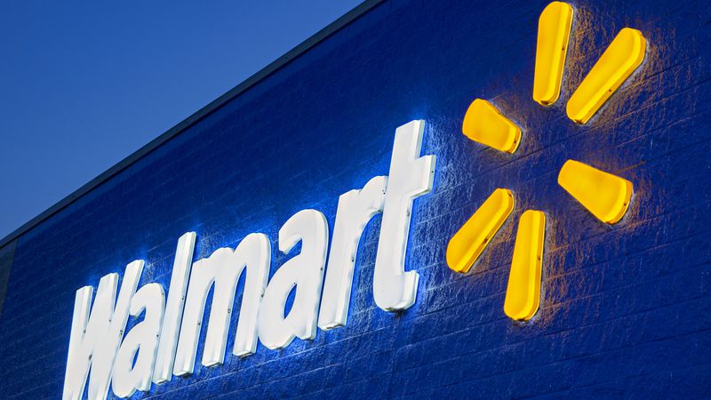 Walmart will no longer require customers or employees who are fully vaccinated to wear masks,...