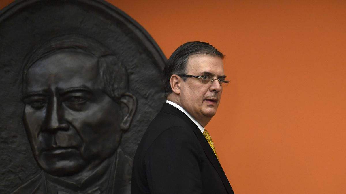 FILE - In this Sept. 10, 2019 file photo, Mexican Foreign Minister Marcelo Ebrard walks past a...
