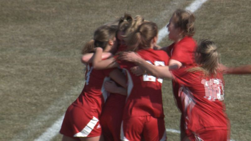 Nebraska soccer players celebrate with Eleanor Dale after her second-half goal against Purdue...