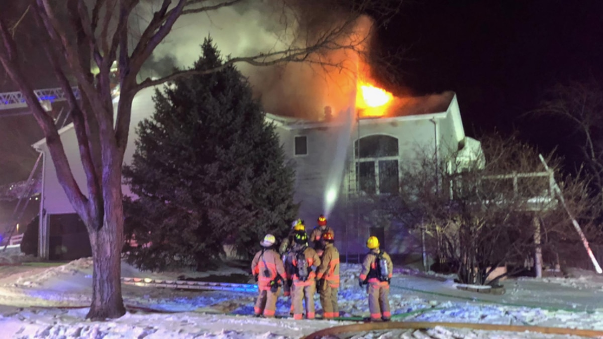 Lincoln Fire & Rescue works to put out a two-alarm house fire in southeast Lincoln early...