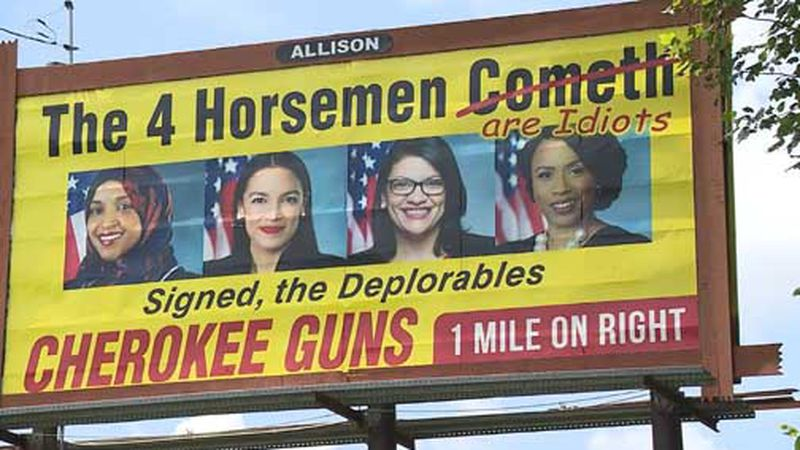 An advertising company says it will take down a North Carolina billboard targeting four...