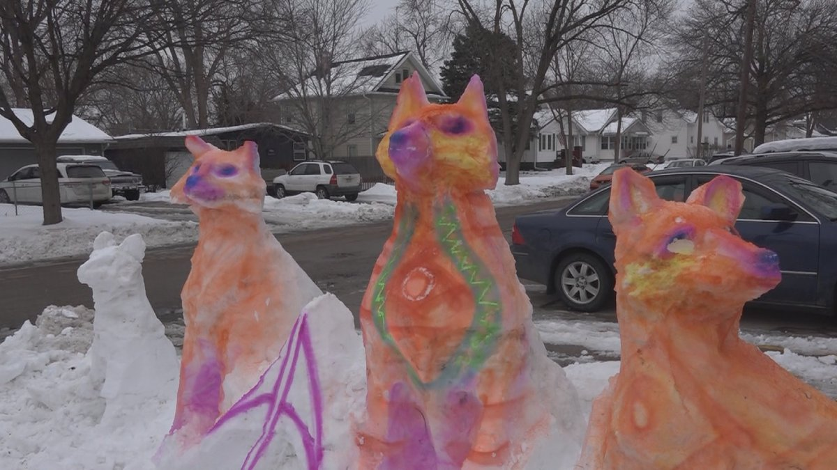 One local artist took advantage of the snow on Sunday and created a colorful sculpture outside...
