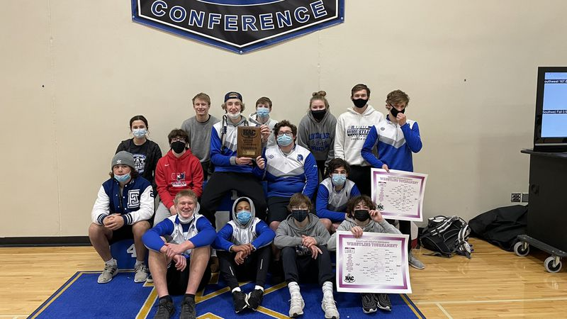 Lincoln East wrestlers pose for a picture following their first-place finish at the HAC...