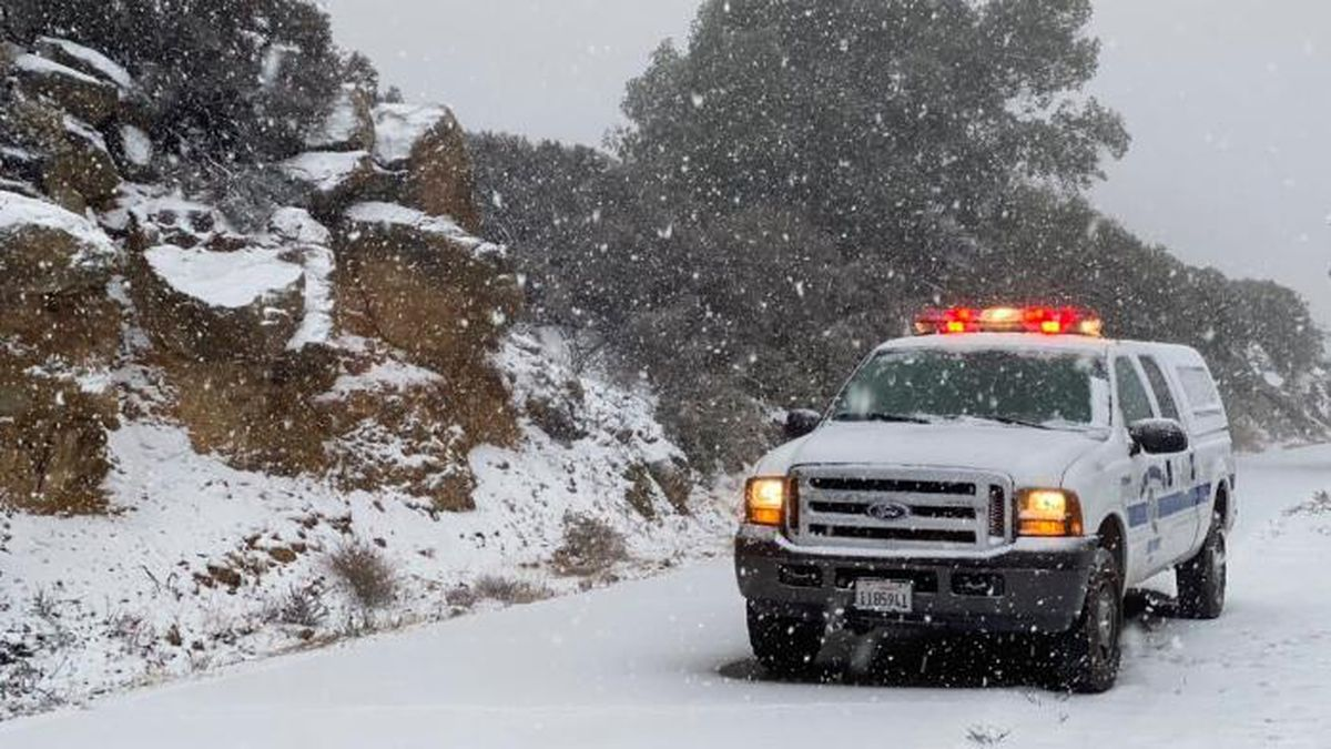 This photo tweeted by the Santa Barbara County Fire Department shows a Santa Barbara Fire Department truck along E. Camino Cielo as snow falls at the 3,500 foot level on the fire footprint in Santa Barbara, Calif. Thursday, Nov. 28, 2019. Wintry weather temporarily loosened its grip across much of the U.S. just in time for Thanksgiving, after tangling holiday travelers in wind, ice and snow and before more major storms descend Friday. (Mike Eliason/Santa Barbara County Fire via AP)