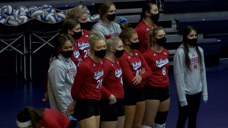 Nebraska volleyball players watch during the Huskers' sweep at Illinois.