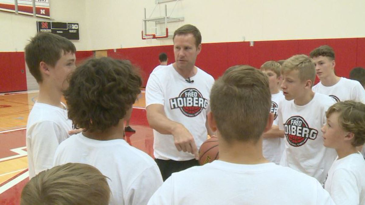 Nebraska Head Coach Fred Hoiberg goes over fundamentals with a group of camp participants.